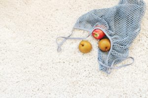 white carpet with fruits scattered